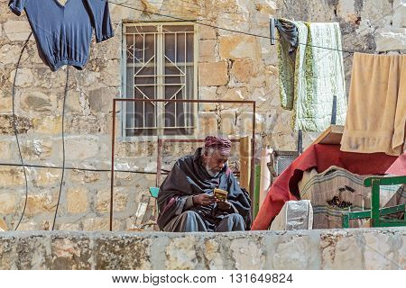 Jerusalem, Israel - February 15, 2013: Priest Of Ethiopian Orthodox Church Sitting On Balcony Near H