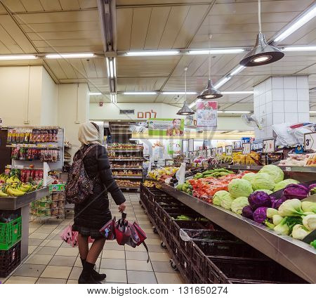 Jerusalem, Israel - February 17, 2013: People Choosing In Produce Section Of Supermarket