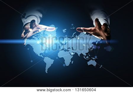 Global networking system with businessman hands over abstract map with network on dark blue background