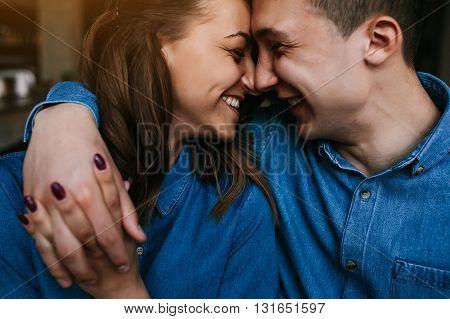 handsome guy and beautiful girl having fun indoors