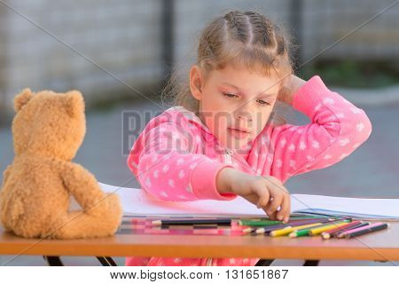 Girl Chooses Carried Away Drawing Pencil With The Desired Color