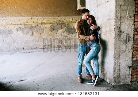 handsome guy and beautiful girl posing in a bystreet