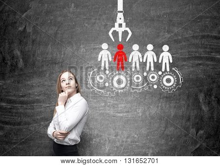 Human resources management and choice concept with thoughtful businesswoman and sketch on chalkboard background