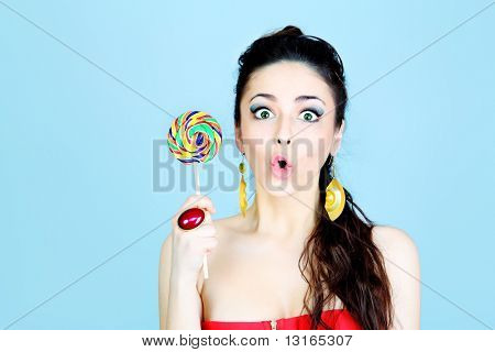 Portrait of a beautiful girl with big lollipop.