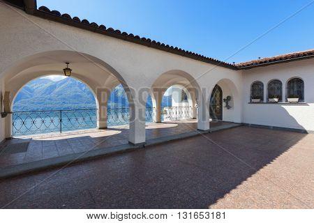 beautiful white villa, backyard with porch