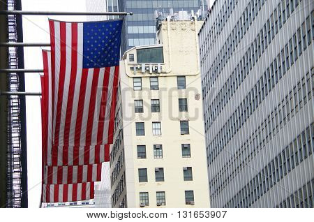 American flags and nyc buildings in  background