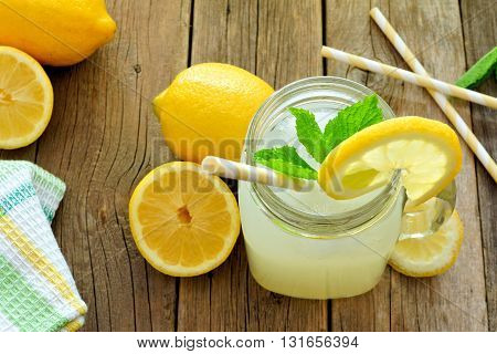 Mason Jar Glass Of Homemade Lemonade On A Rustic Wooden Background, Downward View