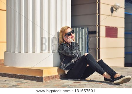 hipster girl sitting with tablet and listening to music
