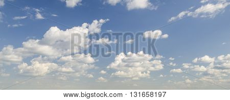 White clouds in deep blue summer sky atmosphere background