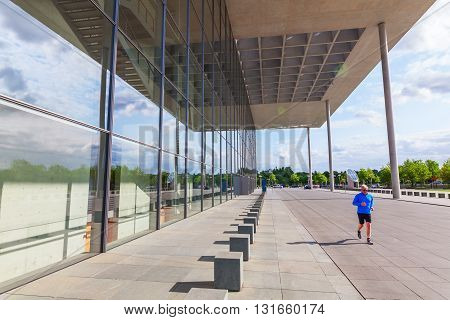 Berlin Germany - May 14 2016: Paul-Loebe-Haus in the government district of Berlin with unidentified people. It is one of the buildings of the German Bundestag