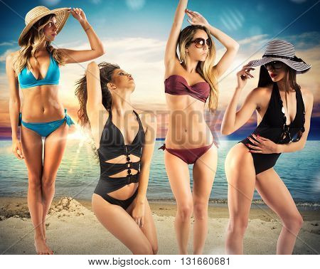 Blondes and brunettes girls in sensual poses on the beach
