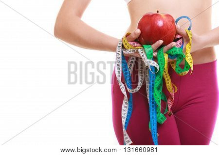 Closeup Of Woman Holding Apple And Tape Measures.
