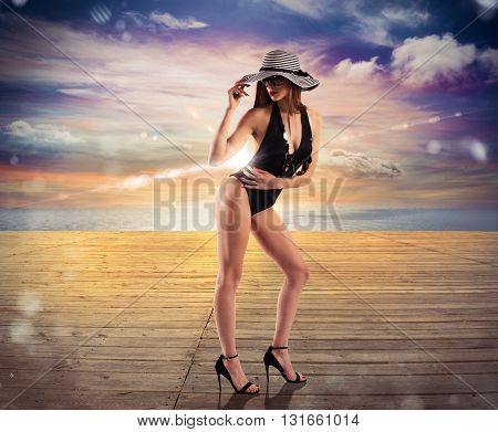 Wooden deck overlooking the ocean with woman