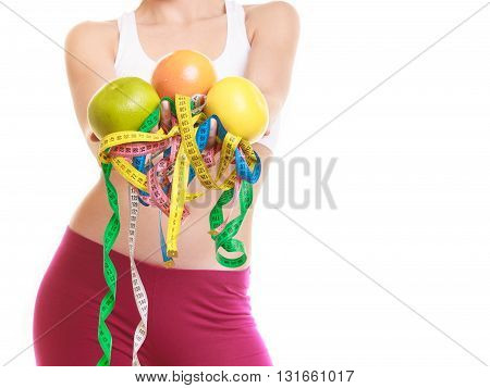 Woman Holding Apple And Tape Measures.