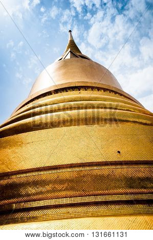 Golden stupa perspective at buddhist temple Bangkok Thailand