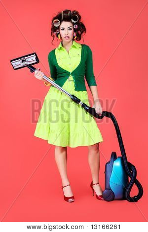 Shot of a funny  woman housewife dressed in retro style.