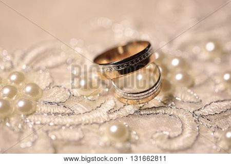 Wedding Bands On Embroidered Cloth