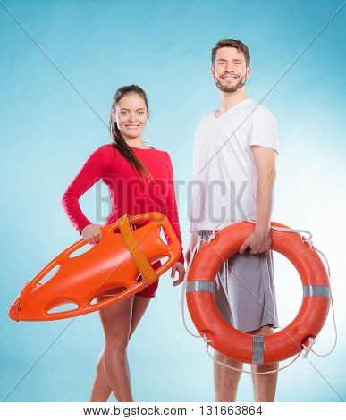 Lifeguards With Rescue And Ring Buoy Lifebuoy.