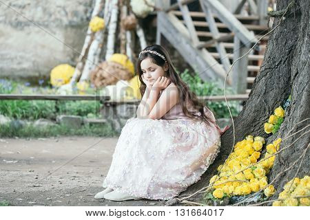 Little Girl Near Tree And Yellow Roses