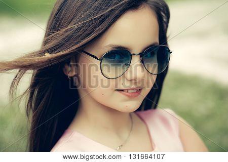 Small Girl In Sunglasses