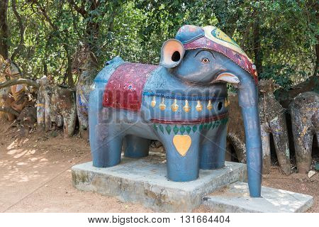 Chettinad India - October 16 2013: Ayyanar village protector Horse shrine of Namunasamudran. Small bluish elephant statue close to altar.