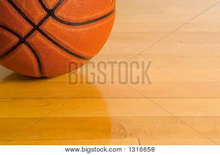 Basketball On Gym Floor