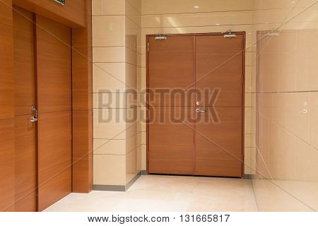 two new doors inside a commercial building