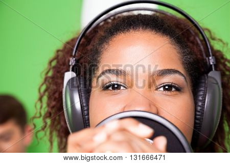 Female Singer Wearing Headphones While Performing