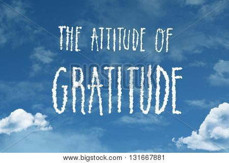 The Attitude of Gratitude cloud word with a blue sky