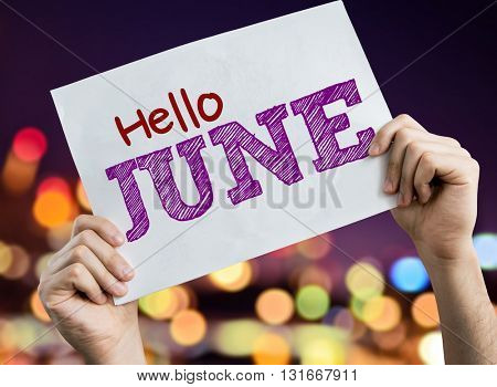 Hello June placard with bokeh background
