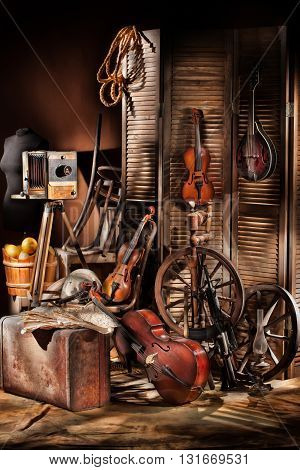 Old photocamera violins on a studio background