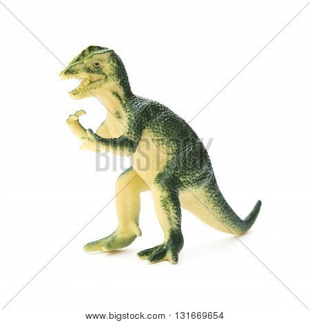 green Dilophosaurus toy on a white background