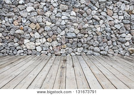 the wooden floor and stone walls background