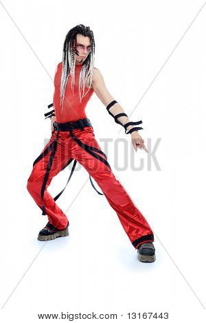 Trendy young man with dreadlocks is dancing. Shot in a studio.