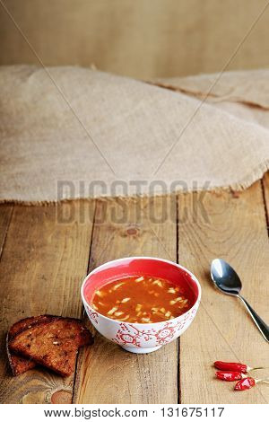 Goulash soup, bread and spoon on a table