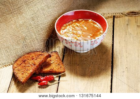 Goulash soup and bread on a wooden table