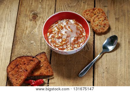 Goulash soup and bread on the wooden table
