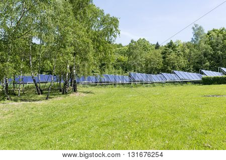 Solar water heaters on green meadow in the mountains Opava. Europe.