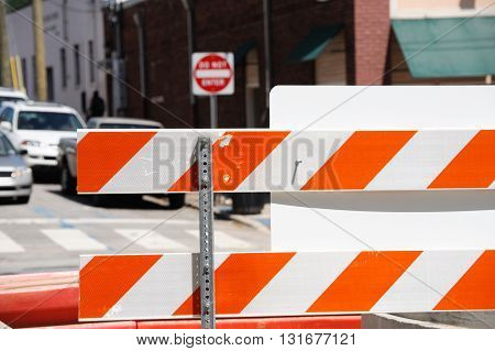 road closed sign and traffic block in the street