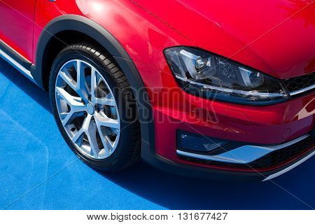 Red car front bumper light and wheel detail with clipping path