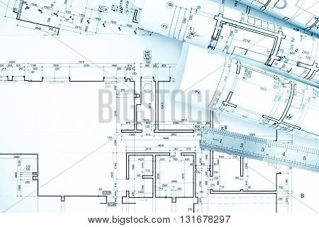 Rolls Of Architecture Blueprints And Plan With Ruler