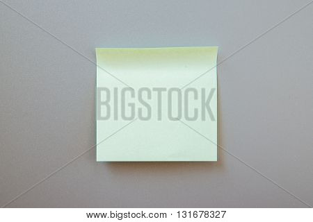 Blank adhesive note for inscription on a label. Front view