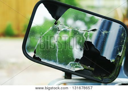 Broken mirror on an abandoned truck. The effect of time and weather in New Orleans Louisana USA