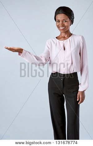 Smiling black african business woman laughing in studio