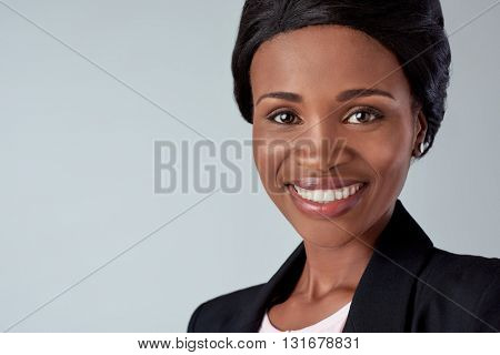 smiling portrait of a beautiful black african woman in studio