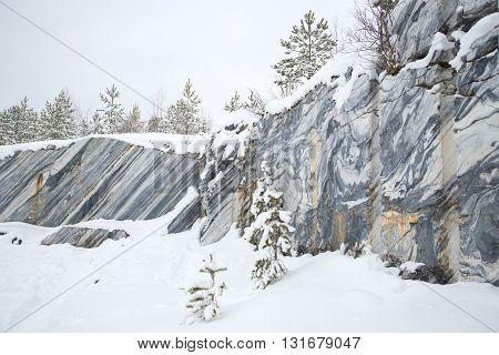 Cloudy winter day in an old marble quarry. Ruskeala, Karelia