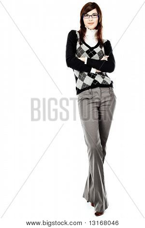 Beautiful young woman posing in business suit and glasses. Isolated over white background.