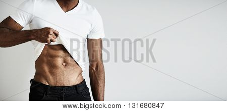 Close Up Of Torso Of Young African Sportsman, Demonstrating His Tense Abs. Sexy Muscular Toned Fit B