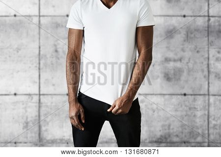 Cropped Portrait Of Attractive African American Man In Trendy Black Jeans And White Copy Space T-shi