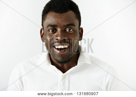 Close Up Shot Of Successful Amused Young African American Office Worker Looking At The Camera In Ast
